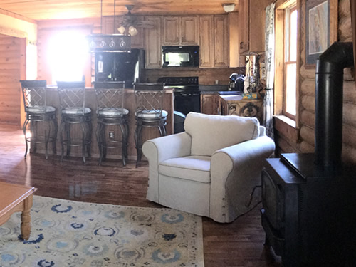 The cabin has an open floor plan - IKEA Ektorp Sofa and Chair - Getting the Cabin Ready to be a Vacation Rental