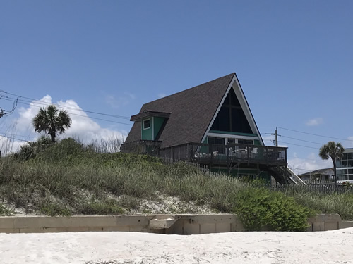 The beach side of the little A-Frame cottage