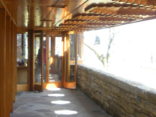 Kentuck Knob has glass walls and hexagonal skylights on the porch. Photo by Eritak