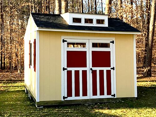 10' × 12' Sundance Series TRS-800 double doors with in-door transom windows, decorative door trim and black hardware l