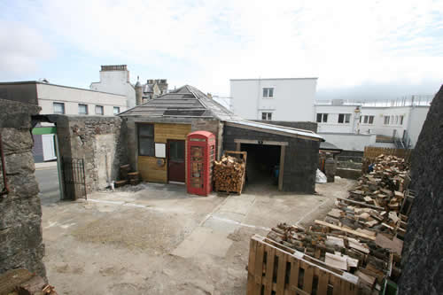This view shows the yard. It is currently used as a builder's yard.