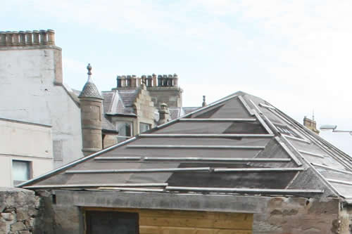 The existing roof But look at those chimneys in the background!