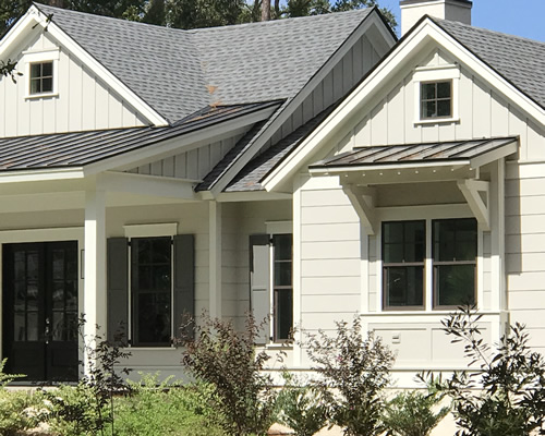 Metal roofs over window and porch and shingles over house