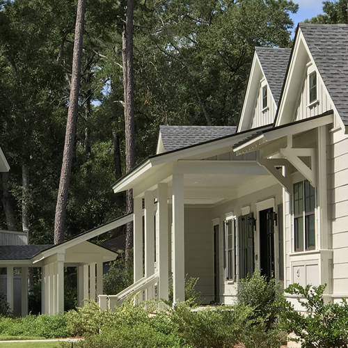 They matched the roof pitch over the window, the porch and the roof over the covered walkway.
