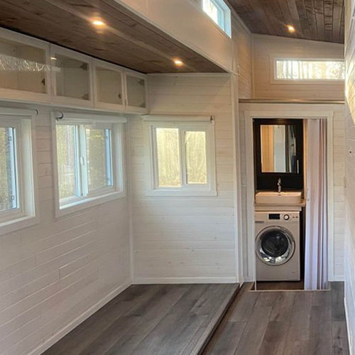 With the slides extended, the Aurora Cappuccino FKS Tiny Home is 15.5' wide.