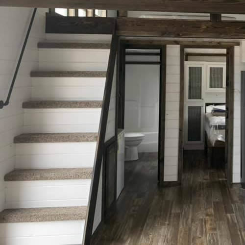 Stairs to the loft over the bedroom and bathroom