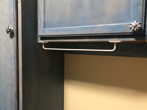 An inexpensive screw on towel bar for hangers