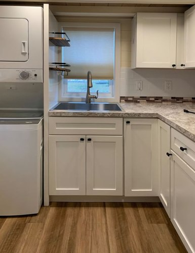 Kitchen and Stackable Whirlpool Washer and Dryer