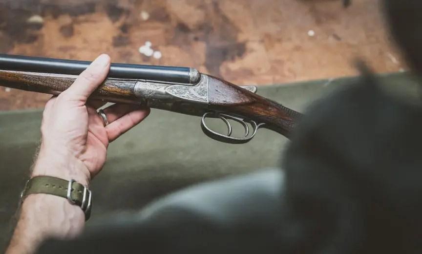 inspecting a vintage shotgun