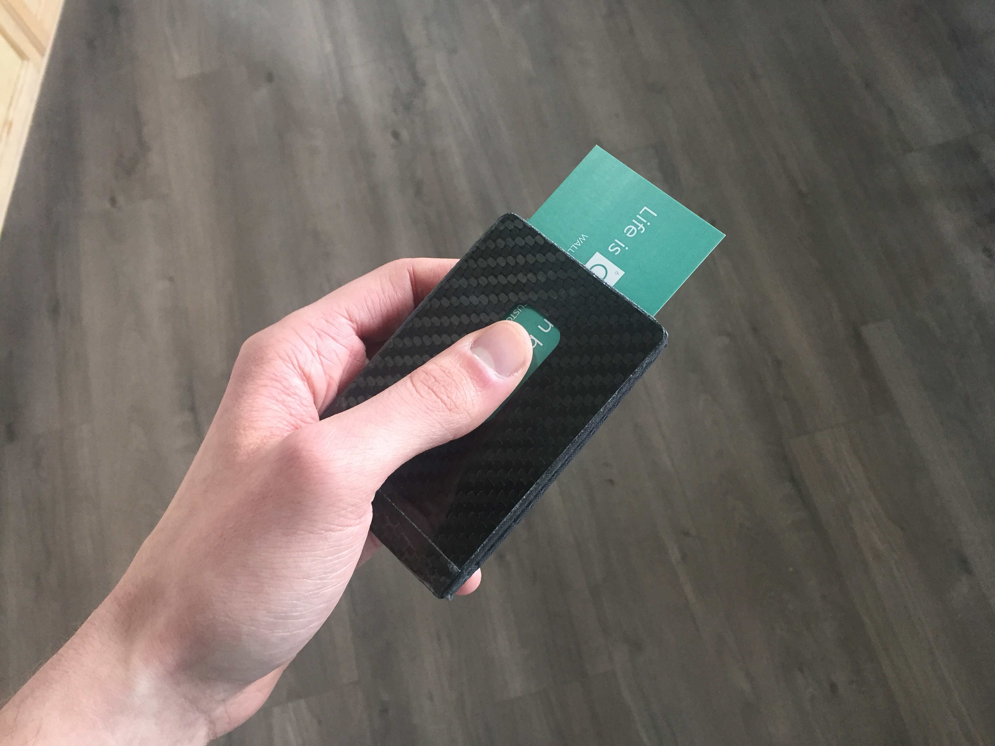 Common Fibers - Carbon Fiber BIZ Wallet Action Shot