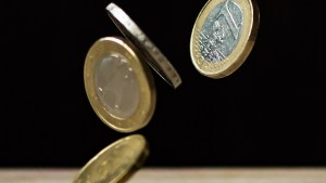 Euro coins falling.