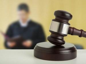 trimis în judecată