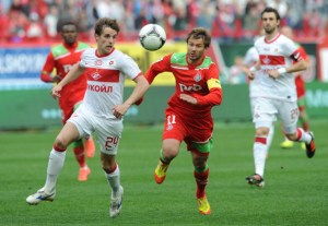 MOSCOW, RUSSIA - MAY 13:  Dmitri Sychev (R) of FC Lokomotiv Moscow battles for the ball with   Kirill Kombarovof  (L) FC Spartak Moscow during the Russian Football League Championship match between FC Lokomotiv Moscow and FC Spartak Moscow at the Lokomotiv Stadium on May 13, 2012 in Moscow, Russia.  (Photo by Fyodor Uspensky/Epsilon/Getty Images)