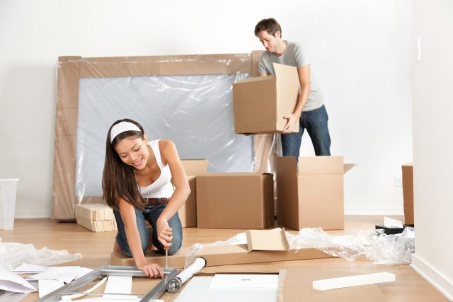 Removal Company - Couple moving in new home house