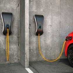 EV Charging Station Mounted To Parking Garage Wall Charging Car