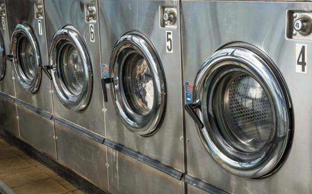 Stainless Steel Commercial Washing Machines Cleaned For CoronaVirus In Multifamily Laundry Room