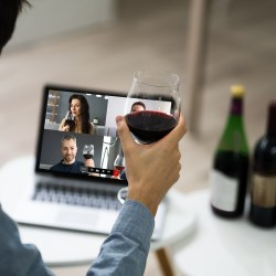 Man Participating In A Virtual Wine Tasting At Laptop With 3 Bottles of Wine For Socially Distanced Resident Events For Winter 2021 Blog