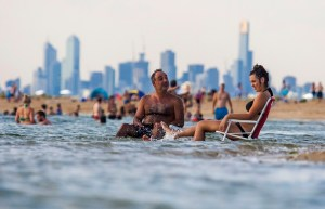 MELBOURNE, AUSTRALIA - JANUARY 14: Melburnians keep cool at Brighton Beach on January 14, 2014 in Melbourne, Australia. Temperatures are expected to reach over 40 degrees Celsius in parts of Victoria over the next four days. (Photo by Craig Sillitoe/Getty Images)