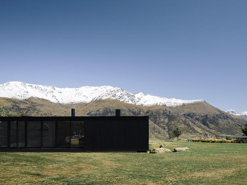 A matte black abode in the hills of New Zealand