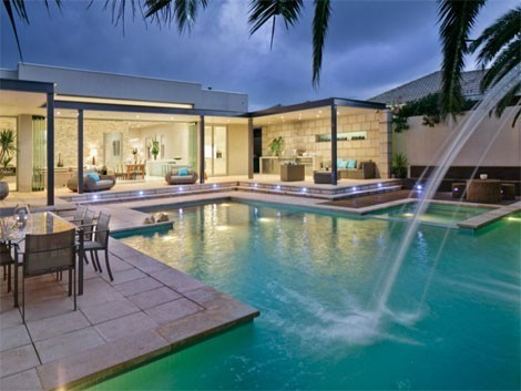 Glass doors slide open to create a big indoor-outdoor space, complete with an outdoor powder room and shower.