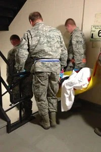 National Guard soldiers carry a patient down a stairwell at Bellevue Hospital on Nov. 1, in New York. (Sheri Fink)