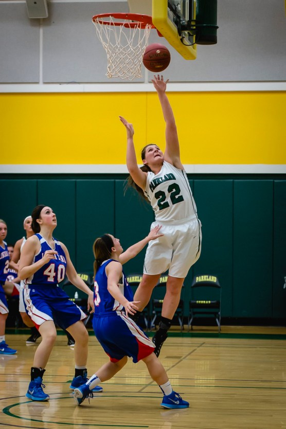 Photo by Scott Wells/Prospectus News Sophomore Center Hannah Wascher scores two points for Parkland on Feb. 25, 2015. The Cobras defeated the Loggers 84-32.
