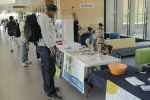 Photo by Zonghui Li   The Prospectus  A Parkland student visits Be The Match's booth and asks informations during the Parkland College Volunteer Fair in the U-Wing on Wednesday, Sept. 23, 2015.