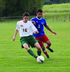 Photo by Ruben Aguilar | The Prospectus  Aidan Reilly tries to keep the ball in possession while a player from the opposing team chases him at the home soccer game vs Heartland on Wednesday, Sept. 2, 2015.