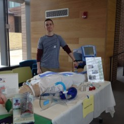 Photo courtesy of Molly Martin | Parkland College Parkland Student Mitch Corlas stands at the Respiratory Club's booth during Parkland's open house.