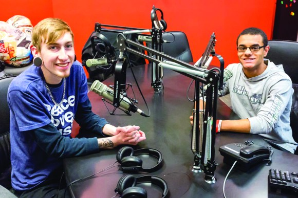 "Photo by Scott Wells | The Prospectus Communications majors Austen Pontious and Alec Ballard sit in the studio of WPCD on Nov. 23, 2015. Pontious and Ballard worked as producers on the recent radio drama presentation ""The ABC Murders."""