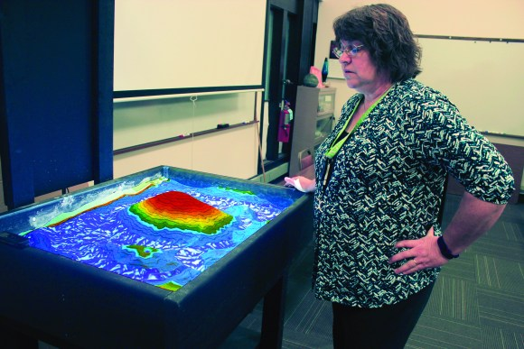 Photo by Zonghui Li | The Prospectus Associate Professor Juile Angel is describing the Augmented Reality Sandbox in L217 on Friday, Feb 12, 2015. This new technology can help Parkland students to know more about the change of landform.