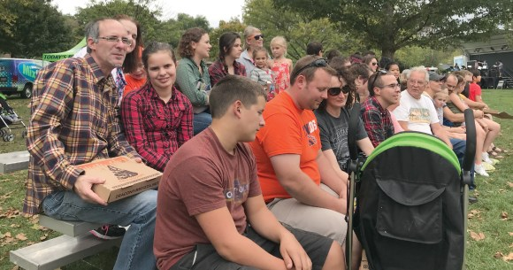 Photo by David Saveanu | Attendees to 2017's Flannel Fest look on during a lumberjack show.