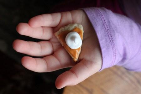 1-tiny-pumpkin-pie-slice-cookie-in-child-hand