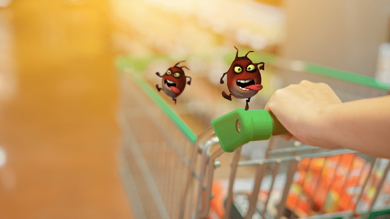 Image of two cartoon style bacteria on a shopping cart handle