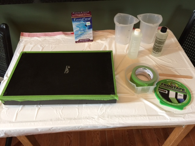 Frog tape to seal edges of tray for DIY photo resin serving tray project