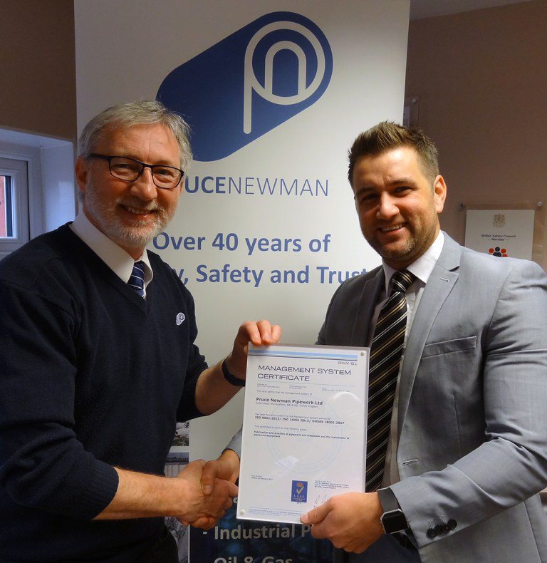 (l-r) Keith Dixon receives Pruce Newman's updated ISO 9001, ISO 14001 and OHSAS18001 certificate from Mark Clewley of DNV-GL