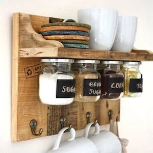120 Cheap and Easy DIY Rustic Home Decor Ideas   Prudent Penny Pincher Rustic Kitchen Cabinet wood pallet  free on craigslist   decorative hooks    jars with metal lids   screws