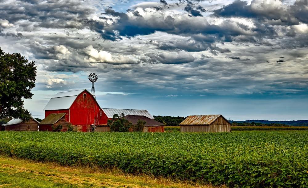 a distant shot of a farmhouse