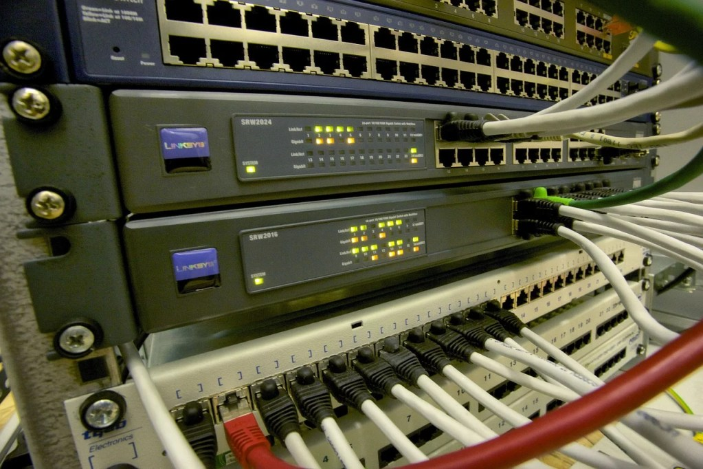 Switches, Routers, and Network Cables in Patch Panels