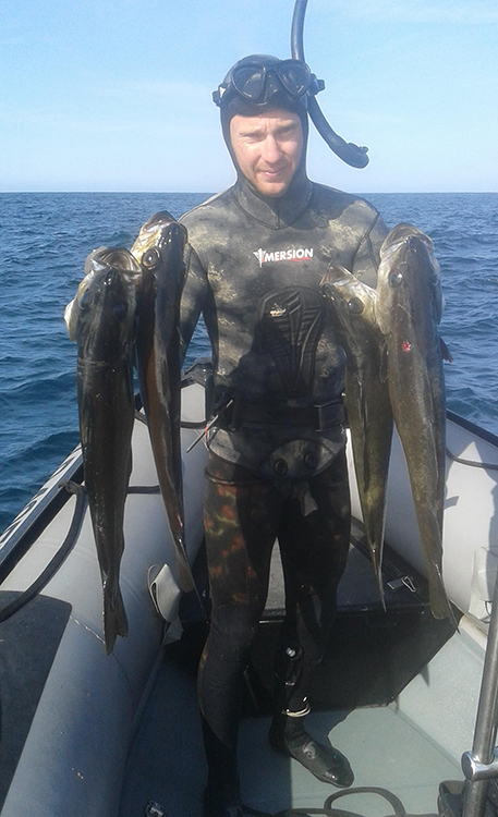 Cédric Tohier et une belle pêche de bar