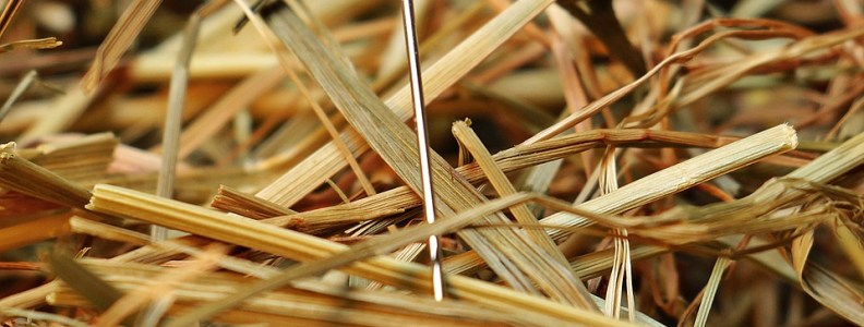 Needle in a haystack represents finding an Outlook email in a pst file.