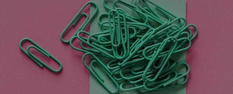 Paper clips representing file attachments.