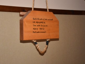 Poem about mindfulness engraved on a wooden block in the Rochester Zen Center