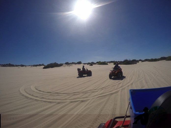 Quad Biking around the soft white sand
