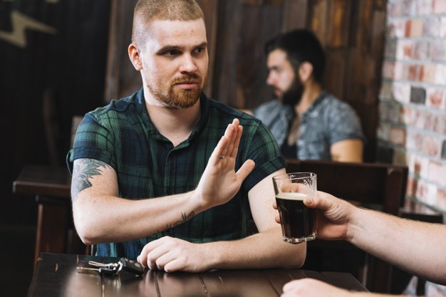 man refuse to drink alcohol