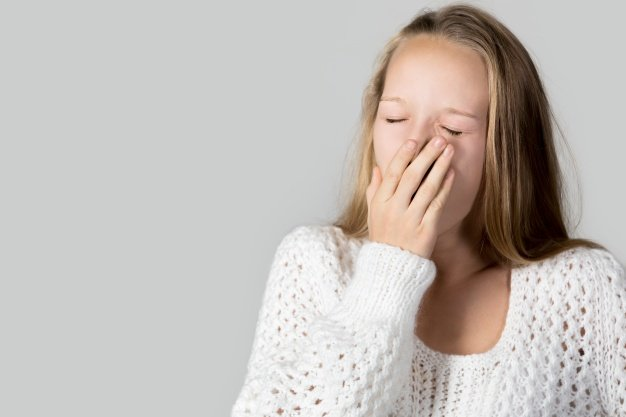 teen girl yawning