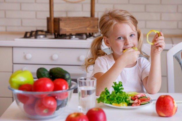 girl eating vegetables