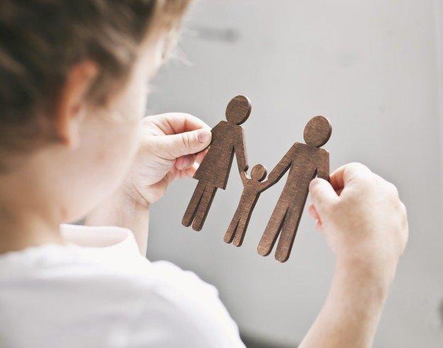 child holding paperdolls