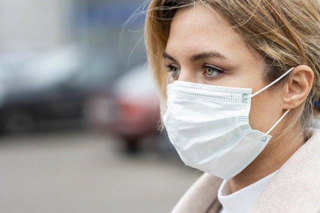 woman wearing mask side view