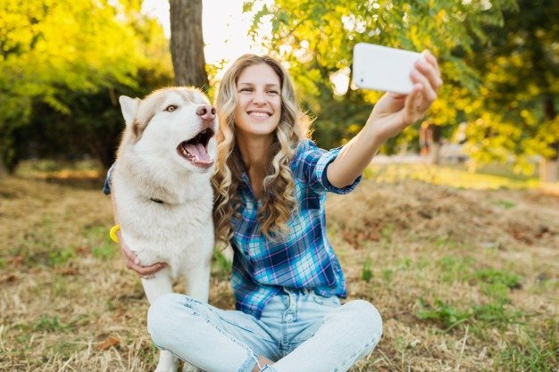 woman having selfie with a dog